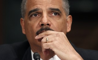 "U.S. Attorney General Eric Holder testifies during a hearing on ""Oversight of the Justice Department""  held by the Senate Judiciary Committee in 2011. The committee held the hearing to investigate ""Operation Fast and Furious,"" a  botched operation to track guns smuggled from the United States to Mexican drug cartels. Photo by Kevin Lamarque/Reuters"