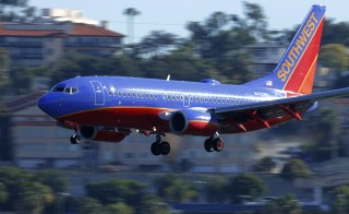 A Southwest Airlines jet comes in to land at Lindbergh Field in San Diego, California February 25, 2015. An airline employee recently removed a California university student from one of its flights after the individual spoke Arabic on his mobile phone before takeoff. Mike Blake/Reuters