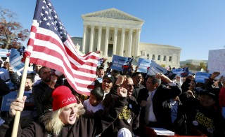 Immigrants and community leaders rally in front of the U.S. Supreme Court to mark the one-year anniversary of President Barack Obama's executive orders on immigration in November 2015. The Obama administration has asked the Supreme Court to revive Obama's executive action to protect millions of illegal immigrants from deportation. Photo by Kevin Lamarque/Reuters