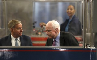 Senator's Lindsey Graham (L) and John McCain (R) talk on the Senate's subway before voting on Capitol Hill in Washington March 17, 2016. REUTERS/Gary Cameron - RTSAY5R