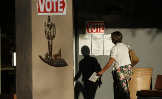 An early morning voter heads in to cast her vote at sunrise in Arizona's presidential primary election at a polling station in Cave Creek, Arizona in March. Photo by Nancy Wiechec/Reuters