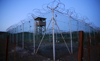 "Chain link fence and concertina wire surrounds a deserted guard tower within Joint Task Force Guantanamo's Camp Delta at the U.S. Naval Base in Guantanamo Bay, Cuba March 21, 2016.  REUTERS/Lucas Jackson      TPX IMAGES OF THE DAY      SEARCH ""GUANTANAMO BAY"" FOR THIS STORY. SEARCH ""THE WIDER IMAGE"" FOR ALL STORIES. ?? - RTSBT9U"