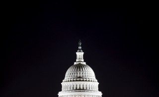 The U.S. Capitol dome is pictured in the pre-dawn darkness in Washington in this file general view photo taken October 18, 2013.    REUTERS/Jonathan Ernst/Files - RTSCJU7
