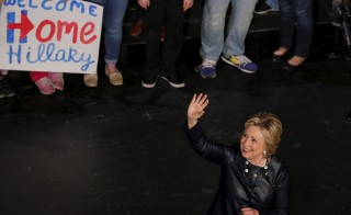 Democratic presidential candidate Hillary Clinton waves to attendees during a campaign rally at the Apollo Theater in Harlem, New York. Photo by Lucas Jackson/Reuters