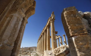 "A view shows the damage at the Monumental Arch in the historical city of Palmyra, in Homs Governorate, Syria April 1, 2016. REUTERS/Omar Sanadiki  SEARCH ""PALMYRA SANADIKI"" FOR THIS STORY. SEARCH ""THE WIDER IMAGE"" FOR ALL STORIES - RTSD6W2"