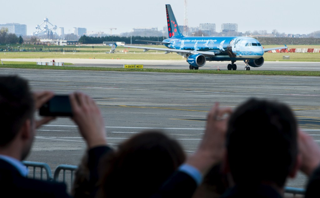 People take pictures while the first plane takes off from Brussels Airport. April 3, 2016. REUTERS/Benoit Doppagne/Reuters