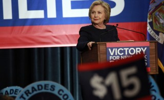 Democratic presidential candidate Hillary Clinton listens to the crowd cheer at a rally to celebrate the state of New York passing into law a $15 minimum wage in New York. Photo by Lucas Jackson/Reuters