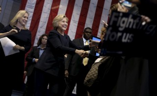 U.S. Democratic presidential candidate Hillary Clinton greets supporters as she arrives at a campaign rally with U.S. Senator Kirsten Gillibrand (D-NY) (L) in Cohoes, New York, April 4, 2016. REUTERS/Mike Segar - RTSDL4W