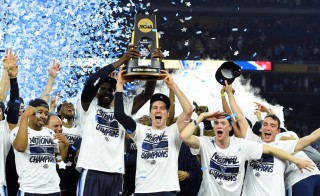 Apr 4, 2016; Houston, TX, USA; Villanova Wildcats guard Ryan Arcidiacono and forward Daniel Ochefu celebrate with the trophy after defeating the North Carolina Tar Heels in the championship game of the 2016 NCAA Men's Final Four at NRG Stadium. Mandatory Credit: Robert Deutsch-USA TODAY Sports - RTSDLKH