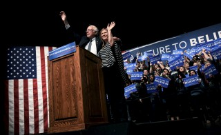 Democratic U.S. presidential candidate Bernie Sanders and his wife Jane wave to the audience at a campaign rally at the University of Wyoming in Laramie, Wyoming April 5, 2016. REUTERS/Mark Kauzlarich - RTSDRQW