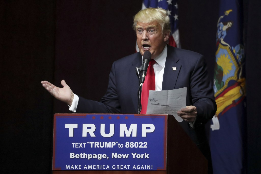 "Republican presidential candidate Donald Trump reads the lyrics of Al Wilson's song ""The Snake"" during campaign event at Grumman Studios in Bethpage, New York April 6, 2016. Trump is taking steps to reshape his campaign following his loss in the Wisconsin GOP primary, which highlighted weaknesses in his operation. Photo by Carlo Allegri/Reuters"