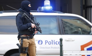 A Belgian special forces police officer stands guard outside a courthouse in Brussels on April 7. Photo by Yves Herman/Reuters