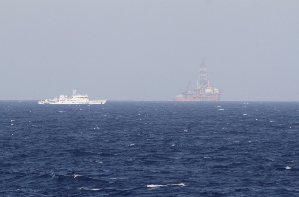 An oil rig (R) which China calls Haiyang Shiyou 981, and Vietnam refers to as Hai Duong 981, is seen in the South China Sea, off the shore of Vietnam in this May 14, 2014 file photo. Vietnam demanded China move a controversial oil rig on April 7, 2016 and abandon plans to start drilling in waters where jurisdiction is unclear, the latest sign of festering unease among the two communist neighbors. Photo by Minh Nguyen/Files TPX/Reuters
