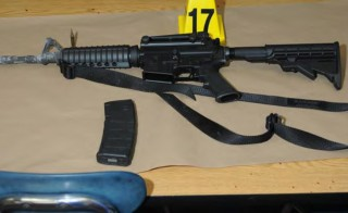 A Bushmaster rifle belonging to Sandy Hook Elementary school gunman Adam Lanza in Newtown, Connecticut is seen after its recovery at the school in this police evidence photo released by the state's attorney's office in November 2013. Photo by Connecticut Department of Justice/Handout via Reuters
