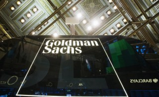 A Goldman Sachs sign is seen above the floor of the New York Stock Exchange shortly after the opening bell in the Manhattan borough of New York January 24, 2014. Photo by Lucas Jackson/Reuters