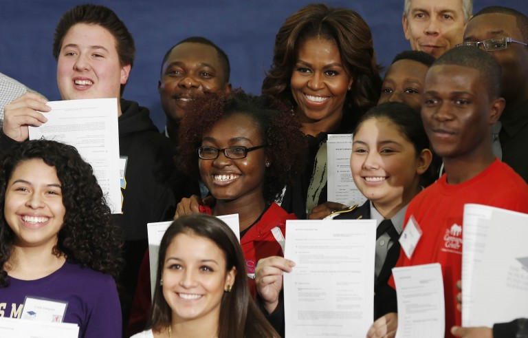 First Lady Michelle Obama poses with parents and students at a Free Application for Federal Student Aid Workshop. Thousands of students nationwide will be taking part in today's National College Signing Day events across the country.