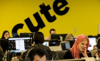Buzzfeed employees work at the company's headquarters in New York January 9, 2014. BuzzFeed has come a long way from cat lists. This month one of its journalists was on the ground in Kiev reporting on the crisis in Ukraine, and last December it published an in-depth article on a Chinese dissident living in Harlem, New York. The kittens haven't disappeared, but these days there is serious journalism as well. Founded in 2006, BuzzFeed is now among the top 10 most-visited news and information sites in the United States. Headquartered in New York, BuzzFeed now has more than 150 journalists, an investigative reporting unit, bureaus in Australia and the United Kingdom, and foreign correspondents in far-flung places like Nairobi and the Middle East. Its expansion comes amid a wave of investor interest in new media companies that are trying to capitalize on a decade-long wave of job cuts at newspapers, and new technology that has upended how news and advertising are produced and distributed. To match Feature USA-MEDIA/BUZZFEED  Picture taken January 9, 2014.  REUTERS/Brendan McDermid (UNITED STATES - Tags: MEDIA BUSINESS SCIENCE TECHNOLOGY) - RTX19CUJ