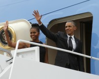 President Barack Obama and first lady Michelle Obama board Air Force One as they depart Joint Base Andrews in 2015. Photo by Kevin Lamarque/Reuters