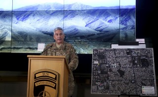 U.S. Army General John Campbell, the commander of international and U.S. forces in Afghanistan, speaks beside a Kunduz city map during a news conference at Resolute Support headquarters in Kabul, Afghanistan, November 25, 2015. The U.S. investigation into a deadly Oct. 3 strike on a hospital run by Medecins Sans Frontieres in the northern Afghan city of Kunduz concluded it was a tragic accident caused primarily by human error, Campbell said on Wednesday. REUTERS/Massoud Hossaini/Pool - RTX1VT9Y