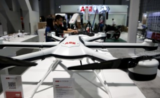 Workers set up a commercial drone display at the AEE Technology booth in the Las Vegas Convention Center during set-up for the 2016 CES trade show in Las Vegas, Nevada, January 5, 2016. In the foreground is a F600 all-weather, carbon fiber drone. The large size means the the drone can carry a larger payload and has better stability in wind, a representative said. REUTERS/Steve Marcus - RTX216CS