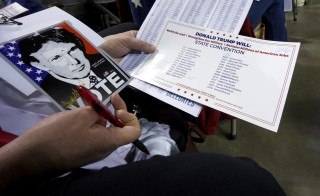 A delegate supporting Republican presidential candidate Donald Trump looks over documents at the Colorado Republican state convention in Colorado Springs, Colorado on April 9. Photo by Rick Wilking/Reuters