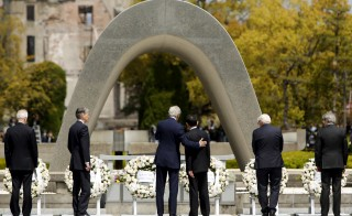 Secretary of State John Kerry, center, puts his arm around Japan's Foreign Minister Fumio Kishida after they and fellow G7 foreign ministers laid wreaths at the cenotaph at Hiroshima Peace Memorial Park and Museum in Hiroshima. Photo by Jonathan Ernst/Reuters
