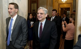 U.S. Supreme Court nominee Judge Merrick Garland walks after a breakfast with Senate Judiciary Committee Chair Senator Chuck Grassley (R-IA) on Capitol Hill Washington, April 12, 2016. REUTERS/Yuri Gripas - RTX29LJI