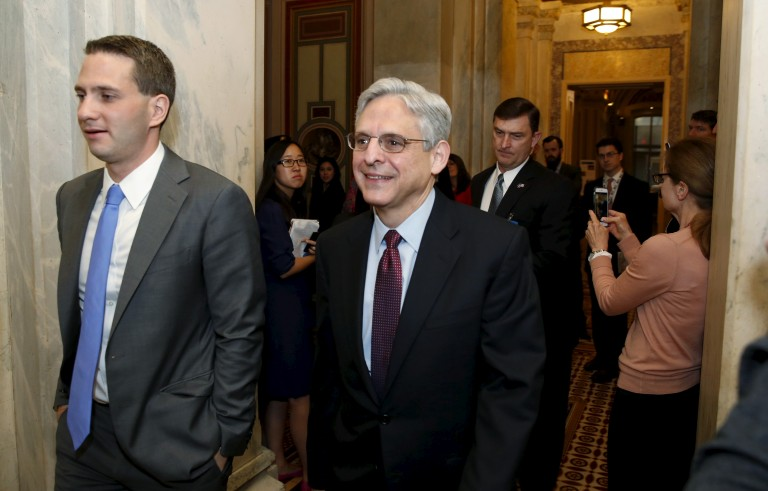 U.S. Supreme Court nominee Judge Merrick Garland walks after a breakfast with Senate Judiciary Committee Chair Senator Chuck Grassley (R-IA) on Capitol Hill Washington, April 12, 2016. REUTERS/Yuri Gripas - RTX29LJI