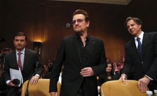 "U2 lead singer Bono arrives to testify before a Senate Appropriations State, Foreign Operations and Related Programs Subcommittee hearing on ""Causes and consequences of violent extremism and the role of foreign assistance"" on Capitol Hill in Washington April 12, 2016. REUTERS/Yuri Gripas - RTX29NC4"