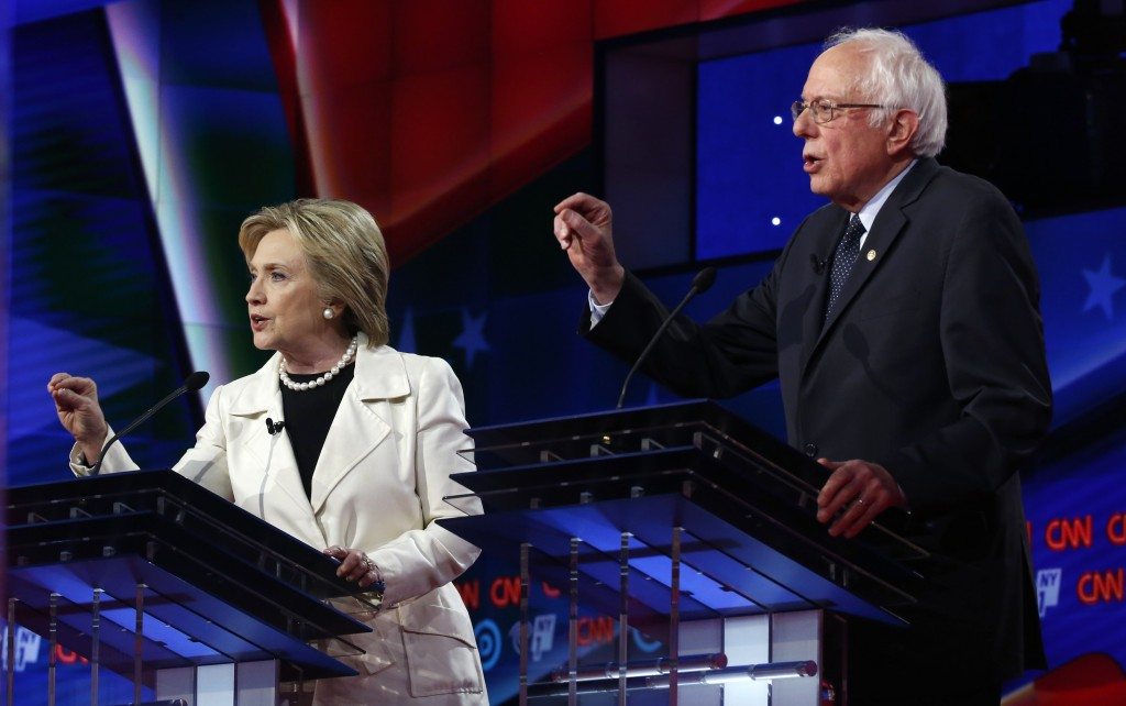 Democratic U.S. presidential candidates Hillary Clinton (L) and Senator Bernie Sanders speak simultaneously during a Democratic debate hosted by CNN and New York One at the Brooklyn Navy Yard in New York April 14, 2016. Photo by Lucas Jackson/Reuters