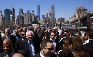 U.S. Democratic presidential candidate Bernie Sanders walks through Brooklyn Bridge Park in the Brooklyn borough of New York April 17, 2016. REUTERS/Lucas Jackson - RTX2ACPR