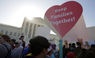Immigration activists rally outside the U.S. Supreme Court as justices hear arguments in a challenge by 26 states over the constitutionality of President Barack Obama's executive action to defer deportation of certain immigrant children and parents who are in the country illegally in Washington April 18, 2016. Photo by Joshua Roberts/Reuters