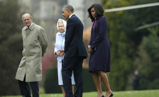 President Barack Obama and first lady Michelle Obama are greeted by Britain's Queen Elizabeth II and Prince Phillip after landing by helicopter at Windsor Castle for a private lunch in Windsor, Britain, on April 22. Photo by Alastair Grant/Pool - via Reuters
