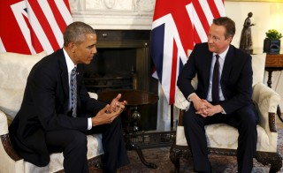 U.S. President Barack Obama talks to British Prime Minister David Cameron at 10 Downing Street in London, Britain on April 22. Photo by Kevin Lamarque/Reuters