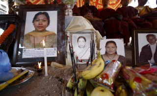 Offerings are seen in front of portraits of earthquake victims during the first anniversary of the earthquake in Kathmandu, Nepal, April 24, 2016. Navesh Chitrakar/Reuters