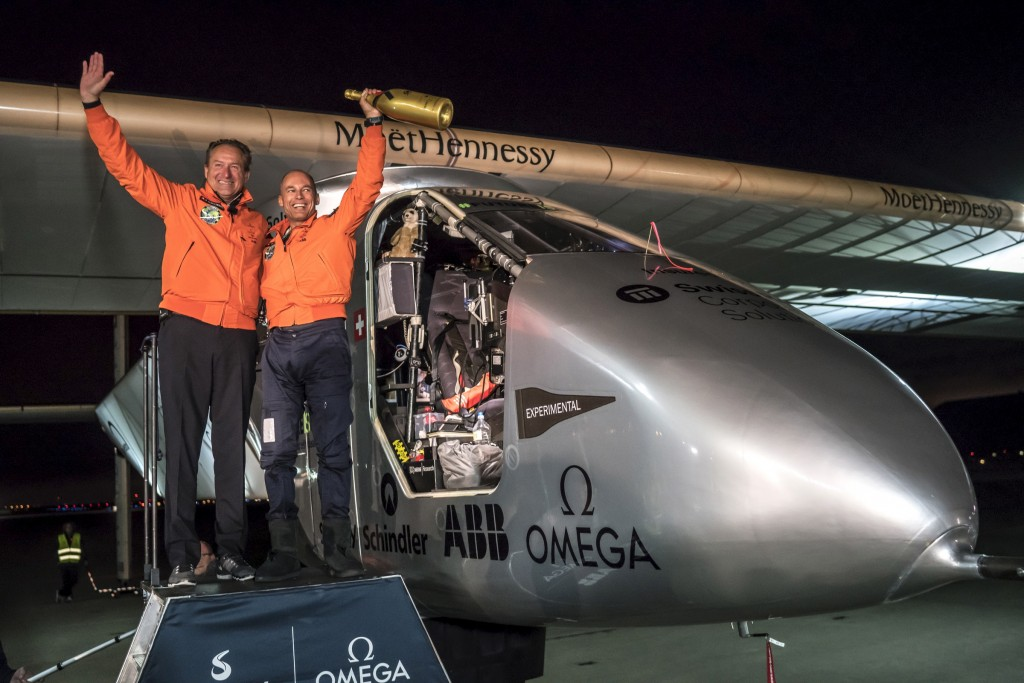 "Swiss pilot Bertrand Piccard (R) reacts together with alternate pilot Andre Borschberg after landing ""Solar Impulse 2"", a solar-powered plane, on Moffett Airfield in Mountain View, California, U.S. April 23, 2016, following a 62-hour flight from Hawaii. Jean Revillard/Solar Impulse/Handout via Reuters"