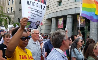 Protesters march to show their opposition against what they called 'Hate Bill 2,' which they urged lawmakers to repeal as legislators convened for a short session in Raleigh, North Carolina April 25, 2016. RREUTERS/Marti Maguire - RTX2BMD1