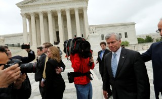 Former Virginia Governor Bob McDonnell is trailed by reporters as he departs after his appeal of his 2014 corruption conviction was heard at the U.S. Supreme Court in Washington, U.S. April 27, 2016. REUTERS/Jonathan Ernst - RTX2BWZH