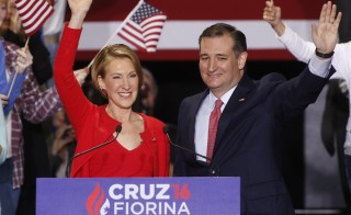 Republican U.S. presidential candidate Ted Cruz waves with Carly Fiorina after he announced Fiorina as his running mate at a campaign rally in Indianapolis, Indiana, United States April 27, 2016.  REUTERS/Aaron P. Bernstein (UNITED STATES  - Tags: POLITICS ELECTIONS)   - RTX2BYHN