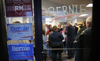Democratic presidential candidate Bernie Sanders talks to supporters as they open a new regional campaign field office in Salem, New Hampshire.. Sanders said he is planning to lay off hundreds of campaign workers nationwide and focus on winning in California, the New York Times reported on Wednesday. Photo by Brian Snyder/Reuters