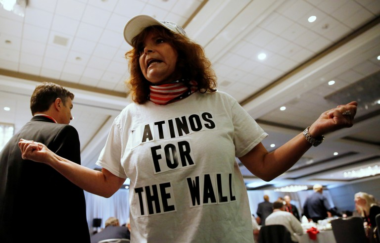 Luisa Aranda, of Brentwood, wears a shirt in support of the border wall while waiting for Republican U.S. presidential candidate Donald Trump during the California GOP convention in Burlingame, California, U.S., April 29, 2016. Stephen Lam/Reuters