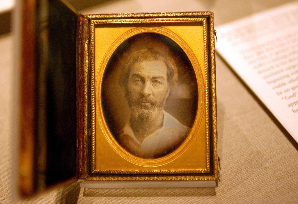 """-PHOTO TAKEN 13SEP05- A daguerreotype of Walt Whitman is displayed at the New York Public Library September 13, 2005.          The daguerrotype is part of an exhibit featuring faded photographs, rare manuscripts and even a lock of Whitman's golden-brown          hair. Titled """"I am With You: Walt Whitman's """"Leaves of Grass"""" (1855-2005)"""" the exhibit opened earlier          this month and runs through the beginning of January. Photo taken on September 13, 2005. - RTXNT4E"""