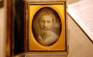 "-PHOTO TAKEN 13SEP05- A daguerreotype of Walt Whitman is displayed at the New York Public Library September 13, 2005. The daguerrotype is part of an exhibit featuring faded photographs, rare manuscripts and even a lock of Whitman's golden-brown hair. Titled ""I am With You: Walt Whitman's ""Leaves of Grass"" (1855-2005)"" the exhibit opened earlier this month and runs through the beginning of January. Photo taken on September 13, 2005. - RTXNT4E"
