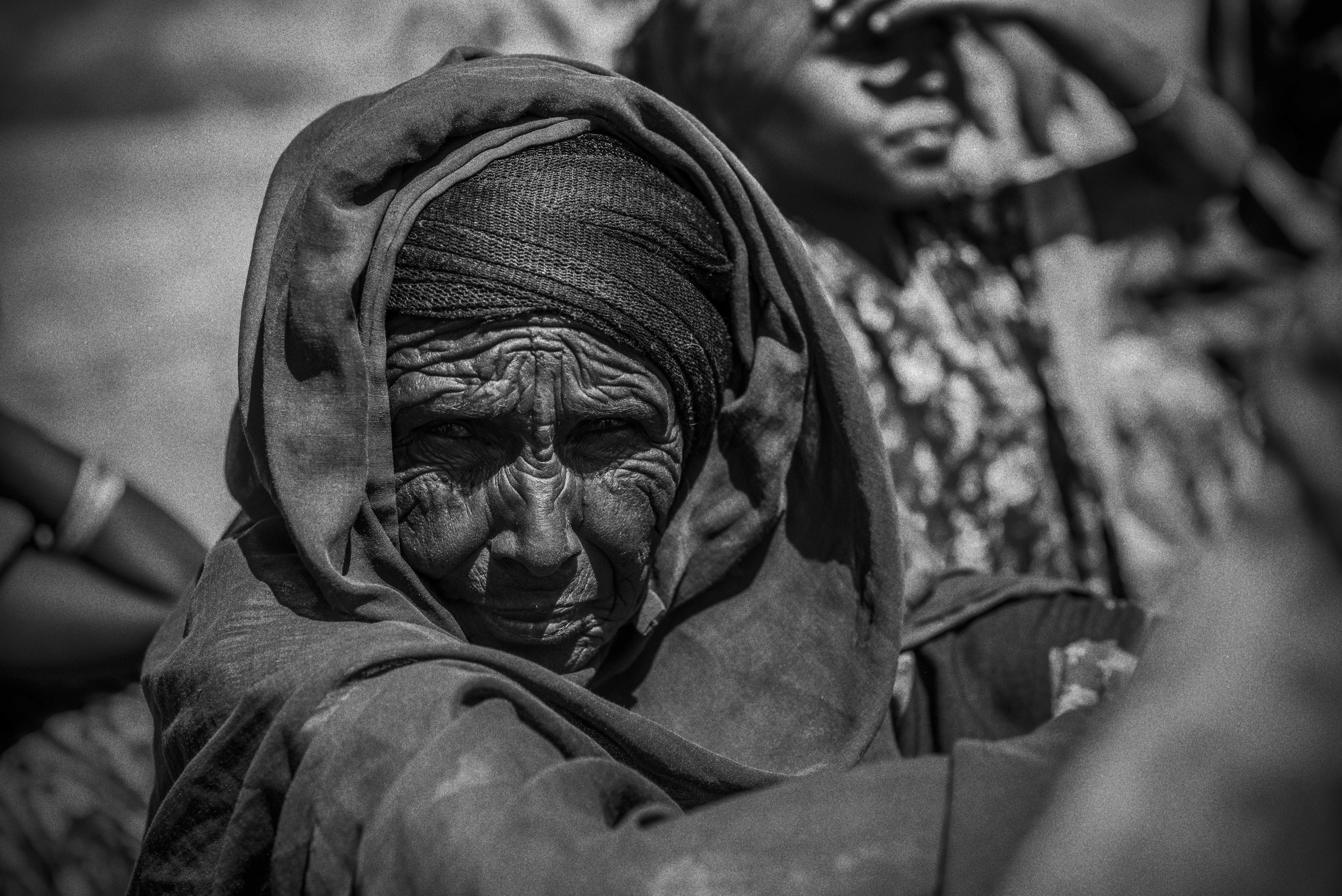An elderly woman is one of more than 1 million Somalis internally displaced due to conflict and drought, according to the United Nations. Photo by Sebastian Rich for UNICEF
