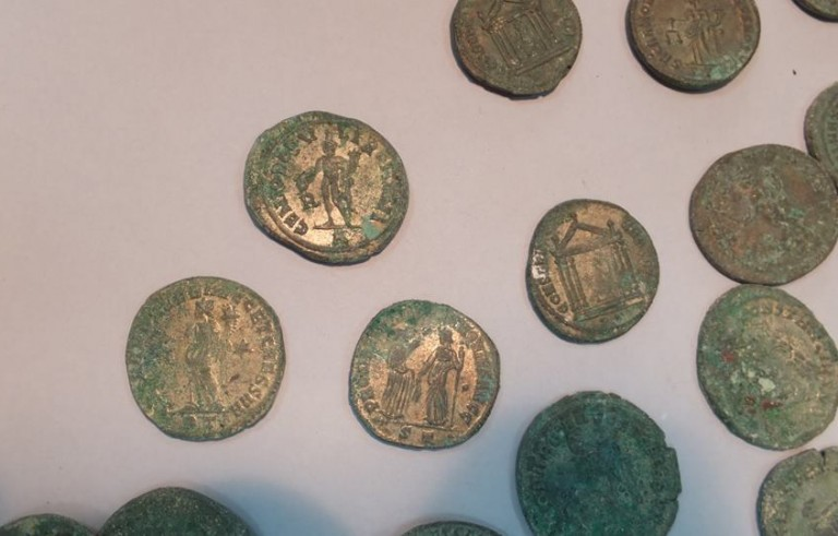About 1,300 pounds of bronze Roman coins dating to the 3rd and 4th centuries were discovered by construction workers digging ditches in Spain. Photo courtesy of the Archeological Museum of Seville