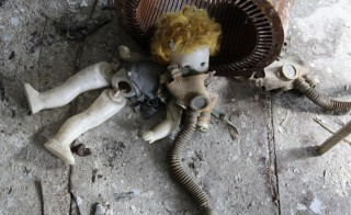 Scene from the former day care facility in the town of Pripyat - the company town for the Chernobyl Nuclear Power Plant. The gas mask in this shot was there as we found it but I suspect it was placed there by a journalist or activist at some point over the years to make an obvious point even more obvious. Photo by Catherine Buell