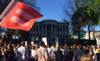 Crowds protest outside the governor's mansion in Jackson, Mississippi, after Governor Phil Bryant signed a law that allows business owners and employees to reject services to LBGTQ people. Photo via Kendall Hardy/Twitter.