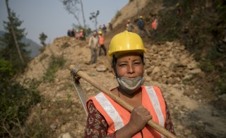 Nirmala Shrestha is one of the villagers in Dhungkhark, Nepal participating in Mercy Corps' cash-for-work program to reinforce landslide-prone areas. Photo taken in March 2016 courtesy of Mercy Corps