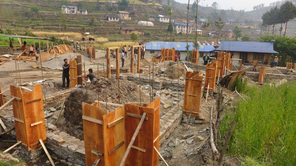 Two classrooms under construction in Eastern Nepal are built with reinforced concrete column buttresses. Photo by Jim Nowak of the dZi Foundation