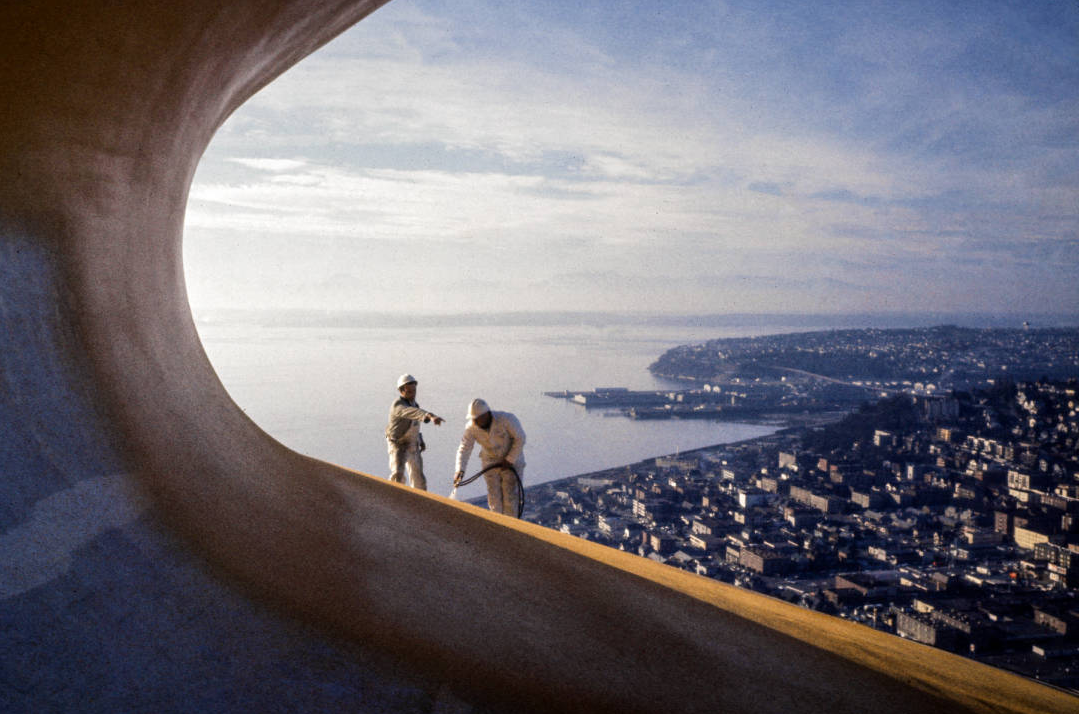 Workers painting Space Needle roof Galaxy Gold, ca. late January 1962. Workers preparing ground for Space Needle foundation, ca. April 1961. Photo by by George Gulacsik, image courtesy of the Seattle Public Library